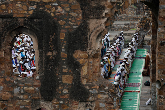 Muslims offer Eid al-Adha prayers at the ruins of Feroz Shah Kotla mosque in New Delhi, India on August 12, 2019. (Photo by Anushree Fadnavis/Reuters)
