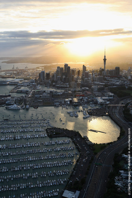 The sun rises over Auckland City during the TelstraClear Challenge in Auckland, New Zealand