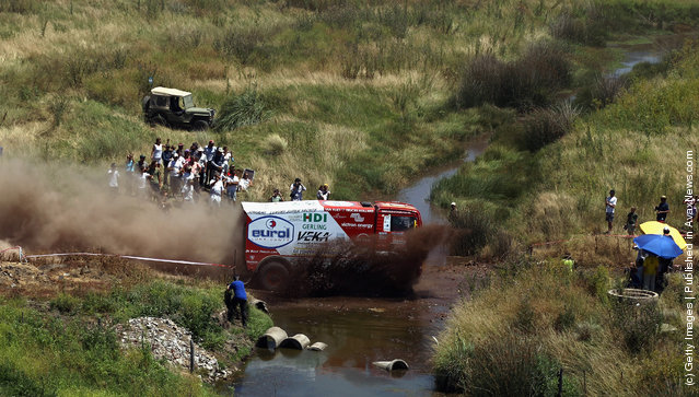 Pieter Versluis of The Netherlands drives his MAN truck through a stream during stage one of the 2012 Dakar Rally