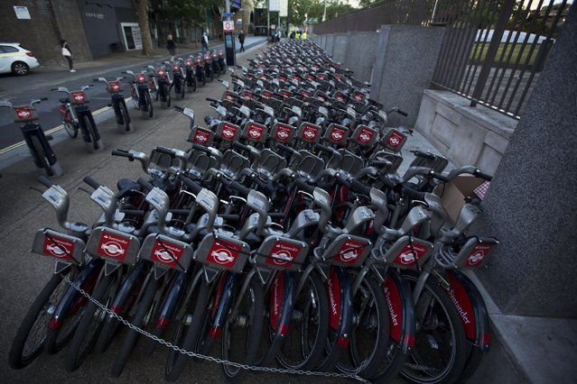 During a 24 hour London underground train strike, a stockpile of hire cycles from a city bike-sharing scheme stand ready at the start of the morning rush hour in London, Thursday, July 9, 2015. London commuters needed to give more time to arrive for work Thursday to navigate a strike that's shut down the city's subway system. (Photo by Matt Dunham/AP Photo)