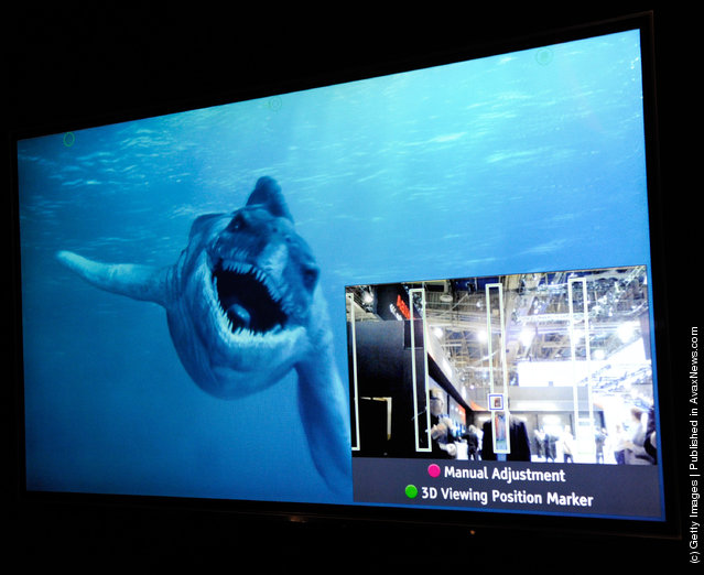 A glasses-free Toshiba 55-inch 3-D 4x full HD TV shows the movie, 'Sea Rex 3D: Journey to a Prehistoric World' at the 2012 International Consumer Electronics Show