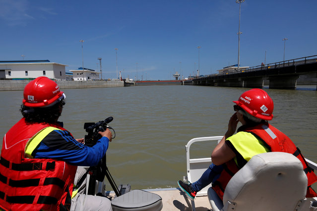 Members of the media film the new the Panama Canal expansion project on the Pacific side of the Panama Canal during an organized media tour by Italy's Salini Impregilo, one of the main sub contractors of the Panama Canal Expansion project, in Panama City May 11, 2016. (Photo by Carlos Jasso/Reuters)