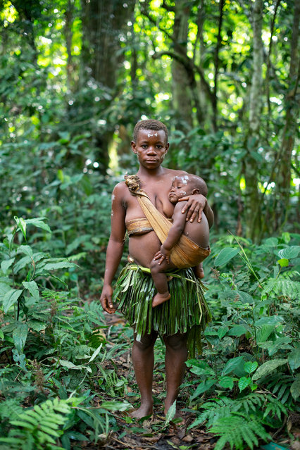 """Akasia"". Bambuti are one of several indigenous pygmy groups in the Democratic Republic of the Congo Bambuti are pygmy hunter-gatherers, and are one of the oldest indigenous people of the Congo region of Africa. During the Congo Civil War, the Bambuti were hunted down and eaten as though they were game animals. Photo location: Ituri forest, DRC. (Photo and caption by Passarini Mattia/National Geographic Photo Contest)"