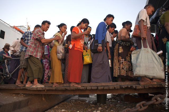 Burmese disembark from a Yangon ferry at rush hour in Yangon, Myanmar