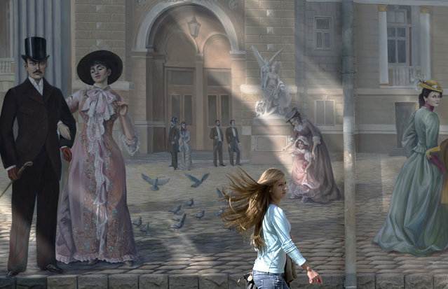 A girl walks past a mural depicting the city's opera house in Odessa, Ukraine, Thursday, May 15, 2014. (Photo by Vadim Ghirda/AP Photo)