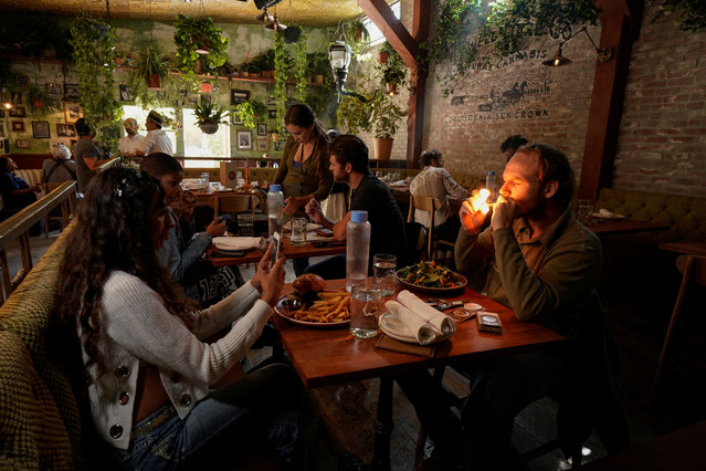 Customers smoke at Lowell Farms,  America's first official Cannabis Cafe offering farm-to-table dining and smoking of cannabis in West Hollywood, California, October 1, 2019. (Photo by Mike Blake/Reuters)