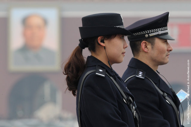 A policeman and a policewoman guard after the opening ceremony of the Chinese People's Political Consultative Conference at the Tiananmen Square on March 3, 2012 in Beijing, China