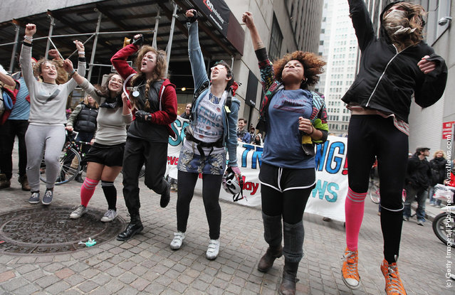 Protesters affiliated with Occupy Wall Street participate in a 'spring training' protest outside the New York Stock Exchange