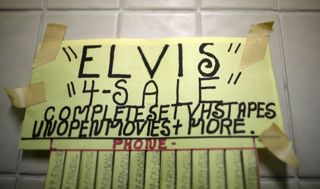 A sign advertising old Elvis Presley VHS cassette tapes is seen taped to the wall at a venue hosting a talent contest during the four-day Collingwood Elvis Festival in Collingwood, Ontario July 25, 2015. (Photo by Chris Helgren/Reuters)