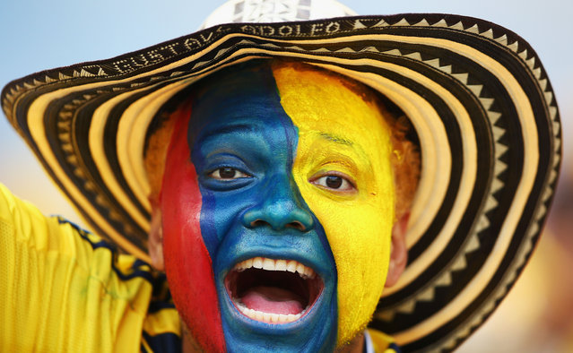 A Colombia fan with a painted face enjoys the atmosphere prior to the 2014 FIFA World Cup Brazil Group C match between Colombia and Greece at Estadio Mineirao on June 14, 2014 in Belo Horizonte, Brazil. (Photo by Paul Gilham/Getty Images)