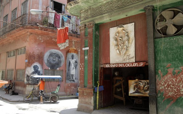 """The entrance to the studio and art gallery of Cuban artist Leo D´lazaro, named """"The Eye of the Hurricane"""", stands open in Old Havana, Cuba, Friday, May 15, 2015. (Photo by Desmond Boylan/AP Photo)"""