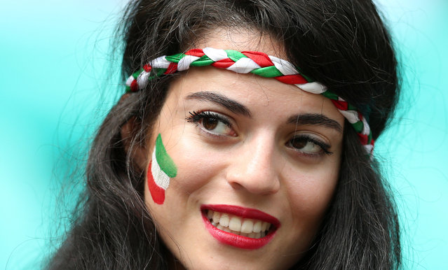 A fan of Iran poses before a Group F football match between Bosnia-Hercegovina and Iran at the Fonte Nova Arena in Salvador during the 2014 FIFA World Cup on June 25, 2014. (Photo by Behrouz Mehri/AFP Photo)