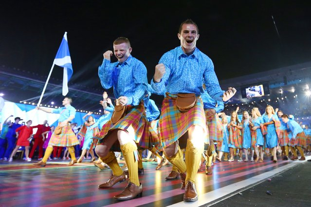Athletes from Scotland cheer as they arrive during the Opening Ceremony for the Glasgow 2014 Commonwealth Games at Celtic Park on July 23, 2014 in Glasgow, Scotland. (Photo by Quinn Rooney/Getty Images)