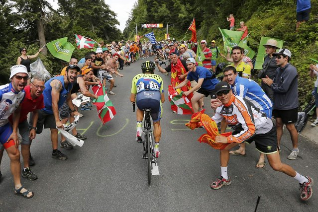 Tinkoff-Saxo team rider Nicolas Roche of Ireland climbs to Pla d'Adet in the Pyrenees mountains during the 124.5km seventeenth stage of the Tour de France cycle race between Saint-Gaudens and Saint-Lary Pla d'Adet, July 23, 2014. (Photo by Jean-Paul Pelissier/Reuters)