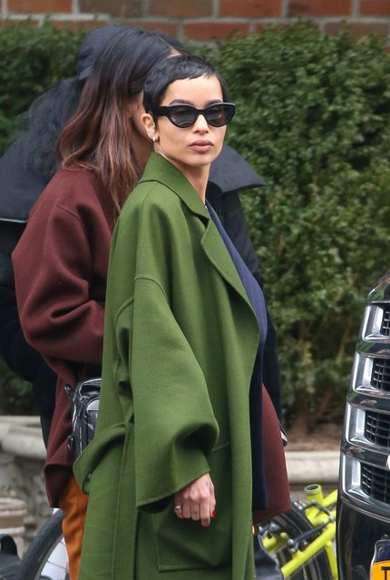 Actress Zoe Kravitz steps out in a long green coat and pinstripe pantsuit for an event during New York Fashion Week on February 12, 2020. (Photo by Backgrid USA)