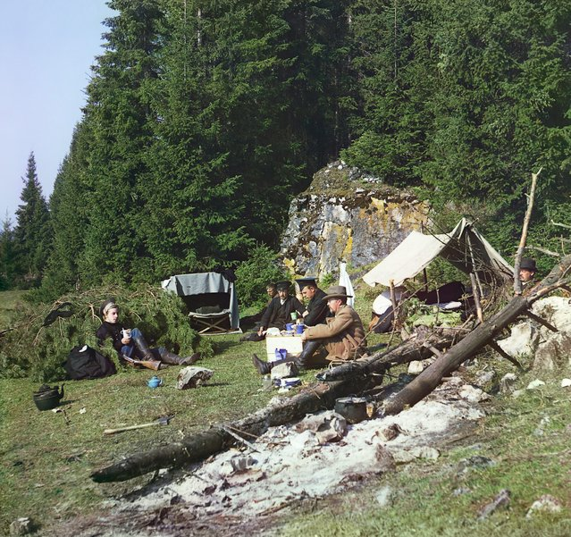 Photos by Sergey Prokudin-Gorsky. Night camp by a rock on the bank of the Chusovaia (Sergei Prokudin-Gorskii and others seated at a campsite). Russia, Perm Province, Kungur uyezd (district), Demidova Utka village area, 1912
