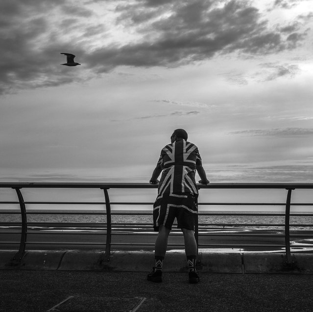 A Punk Rocker relaxes looking out to sea as punks gather in Blackpool for the annual Rebellion Punk Rock Festival in Blackpool. (Photo by Christopher Furlong/Getty Images)