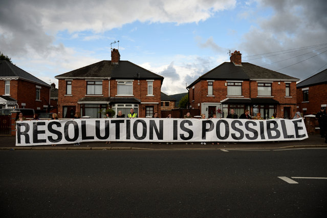 A sign saying Resolution is Possible is seen before the Twelfth of July  Orange Order March passes through the Crumlin Road in Belfast, Northern Ireland, July 12, 2016. (Photo by Clodagh Kilcoyne/Reuters)