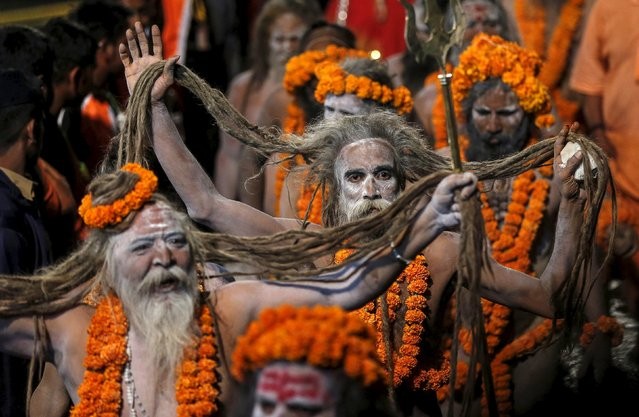 Naga Sadhus, or Hindu holy men, arrive to take a dip in a holy pond during the first Shahi Snan (grand bath) at Kumbh Mela, or Pitcher Festival, in Trimbakeshwar, India, August 29, 2015. (Photo by Shailesh Andrade/Reuters)