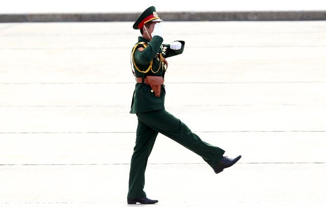 A military officer salutes while marching during a parade marking Vietnam's 70th National Day at Ba Dinh square in Hanoi, Vietnam September 2, 2015. (Photo by Reuters/Kham)