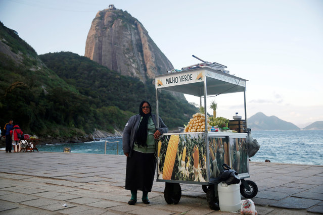 """Ducinea Rancheiro, a 48-year-old street vendor, poses for a portrait at the Praia Vermelha (Red Beach) in Rio de Janeiro, Brazil, June 25, 2016. When asked what she thought about Rio de Janeiro hosting the Olympics, Ducinea said, """"I am not a person who identifies with sports, but it will be good because it has given people work by generating jobs mostly in the tourism sector"""". (Photo by Pilar Olivares/Reuters)"""