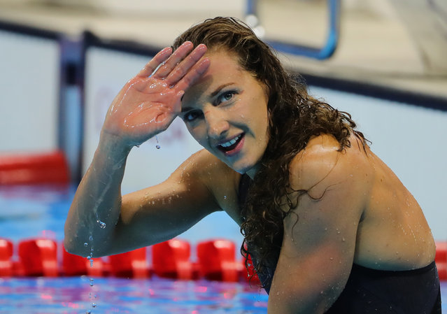 Katinka Hosszu of Hungary celebrates after winning the Women's 100m Backstroke Final of the Swimming events during the Rio 2016 Olympic Games at the Olympic Aquatics Stadium in Rio de Janeiro, Brazil, 8 August 2016. (Photo by Michael Kappeler/DPA via Newscom)