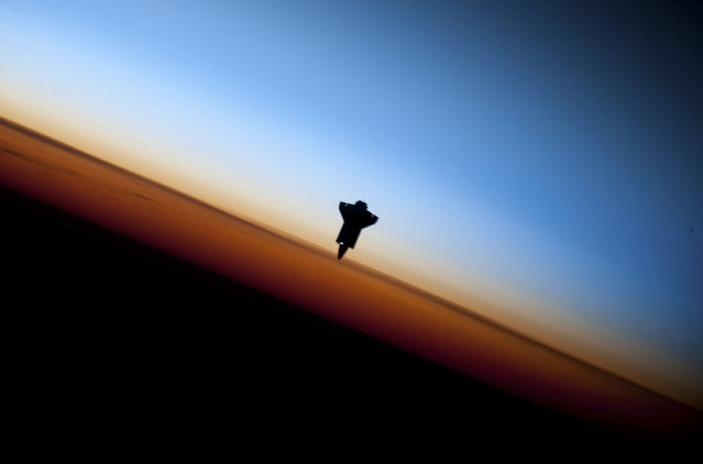 The space shuttle Endeavour silhouetted against the backdrop of Earth's horizon prior to docking with the International Space Station, February 9, 2010. (Photo by Reuters/NASA)