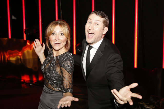 Sasha Alexander, left, and Scott Aukerman pose backstage at the Television Academy's Creative Arts Emmy Awards at Microsoft Theater on Saturday, September 12, 2015, in Los Angeles. (Photo by Colin Young-Wolff/Invision for the Television Academy/AP Images)