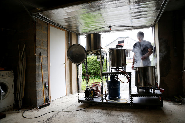 Arnaud Laloy, member of the Belgian Homebrewers association, starts making his own beer in the garage of his house in Neufchateau, Belgium, August 11, 2016. (Photo by Francois Lenoir/Reuters)