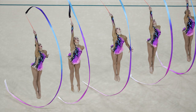 Team Germany performs during the rhythmic gymnastics group all-around qualifications at the 2016 Summer Olympics in Rio de Janeiro, Brazil, Saturday, August 20, 2016. (Photo by Rebecca Blackwell/AP Photo)