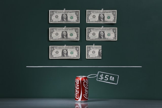 A can of Coca-Cola as photographed in a studio with an illustrative price tag of $5.56 (US dollars), equivalent to the Bs. 35 (bolivars) that it costs on average to purchase in Caracas at the official exchange rate of 6.3 bolivars per dollar, in Caracas September 29, 2014. (Photo by Carlos Garcia Rawlins/Reuters)