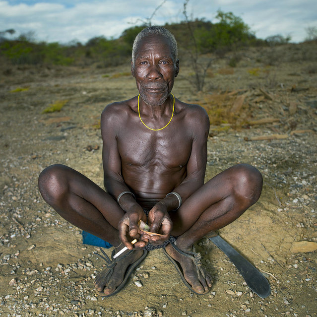"""""""The man who sold his wife to his friend – Mucubal Angola. This man sold his wife to his best friend. It is possible in Mucubal tribe! For 2 cows ( a huge price as a cow costs something like 1000 us dollars) In Mucabale tribe, you can buy the wife of someone"""". (Eric Lafforgue)"""