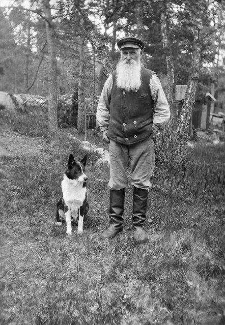 Carl Persson, Betsede, Uppland, Sweden, 1929. The farmer Carl Persson, 69 years old, with a dog. (Photo by Einar Erici)