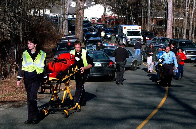 Paramedics push stretchers toward Sandy Hook Elementary School . (Photo by Shannon Hicks/Newtown Bee)
