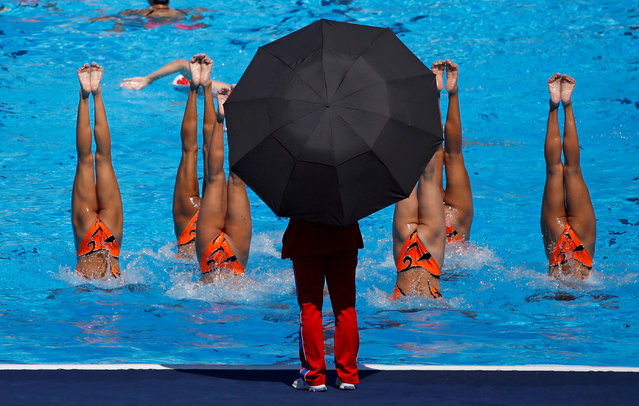 North Korea's synchronised swimming team practice under coach supervision during the World Aquatics Championships, Team Technical Final in Budapest, Hungary, July 18. (Photo by Stefan Wermuth/Reuters)