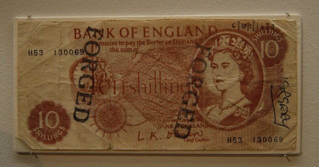 A forged British 10 shilling note from the late 1950's is displayed as part of the Crime Museum Uncovered exhibition at the Museum of London in the City of London, Wednesday, October 7, 2015. (Photo by Alastair Grant/AP Photo)