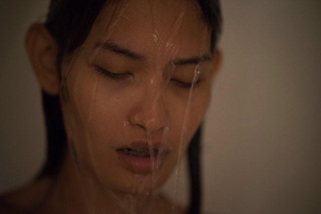 "Kritchaya ""Lolita"" Boonhor has shower after making love with one of her boyfriends, in Bangkok, Thailand, 29 November 2017. (Photo by Lola Levan/EPA/EFE)"