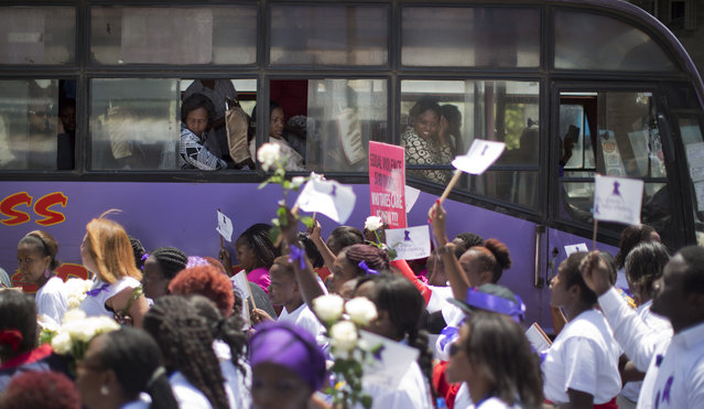 Bus passengers look out of their windows as Kenyan women protest for the right to wear whichever clothes they want, at a demonstration in downtown Nairobi, Kenya Monday, November 17, 2014. (Photo by Ben Curtis/AP Photo)