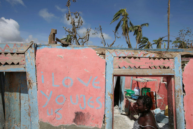 A woman enters her house which was destroyed by Hurricane Matthew in the outskirts of Port Salut, Haiti, October 7, 2016. (Photo by Andres Martinez Casares/Reuters)