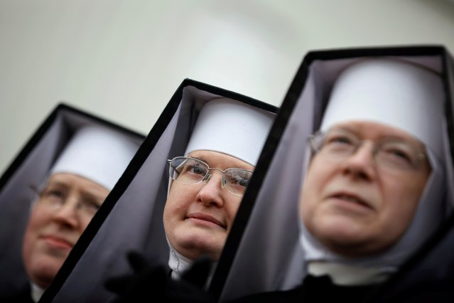 Nuns attend a campaign rally by Donald Trump at Michigan Sports Stars Park in Washington, Michigan on November 1, 2020. (Photo by Carlos Barria/Reuters)