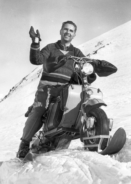 "Jean Studer riding a motor-bike on skis on a snow covered pass in the ""Cantine de Proz"", circa 1955.  (Photo by Fox Photos/Getty Images)"