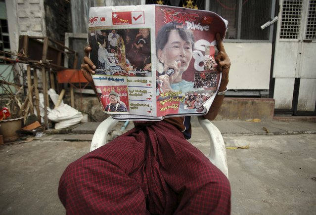 A man reads the newspaper outside his home in Yangon in this April 1, 2012 file photo. Anyone reading Myanmar's independent media ahead of the historic election on November 8, 2015, might be unaware over 90 political parties are competing, as online platforms and newspapers are plastered with the image of one candidate - Nobel laureate Aung San Suu Kyi. (Photo by Reuters/Staff)