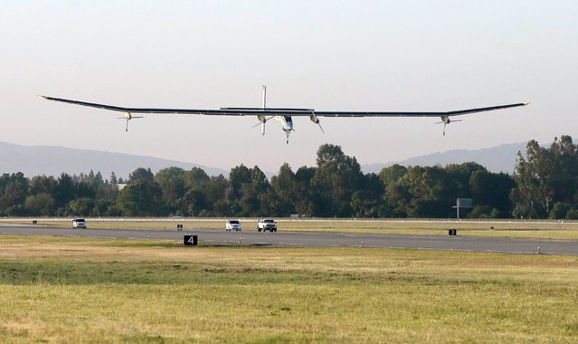The Solar Impulse lands during a test flight at Moffett Field NASA Ames Research Center in Mountain View, Calif., Friday, April 19, 2013. A solar-powered plane that has wowed aviation fans in Europe is set to take an early morning test flight over the San Francisco Bay area. Considered the world's most advanced sun-powered plane, the SolarImpulse is set to take off from Moffett Field in Mountain View at first light for a two-hour practice run leading up to the start of a multi-city, cross-country tour. (Photo by Jeff Chiu/AP Photo)