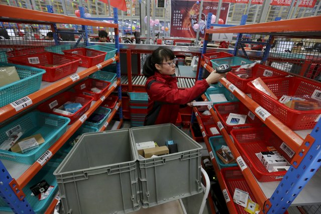 An employee works at a JD.com logistic centre in Langfang, Hebei province, November 10, 2015. (Photo by Jason Lee/Reuters)