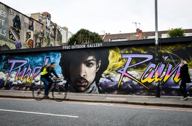 A mural of Prince in Stokes Croft, designed by the artists Paintsmiths of Bristol, UK on October 19, 2016. (Photo by Ben Birchall/PA Wire)