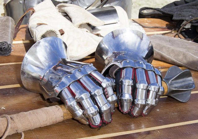 "Metal gloves lay on a table during the ""Battle of Nations"" in Aigues-Mortes, southern France, Friday, May 10, 2013 where Middle Ages fans attend the historical medieval battle  competition. The championship will be attended by 22 national teams, which is twice the number it was last year. The battle lasts until May 12. (Photo by Philippe Farjon/AP Photo)"