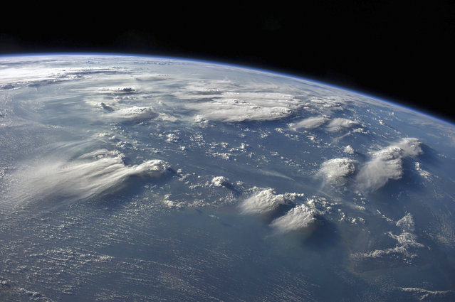 Borneo thunderstorms taken by astronauts aboard the International Space Station (ISS) on August 5, 2014. (Photo by NASA/SPL/Barcroft Media)