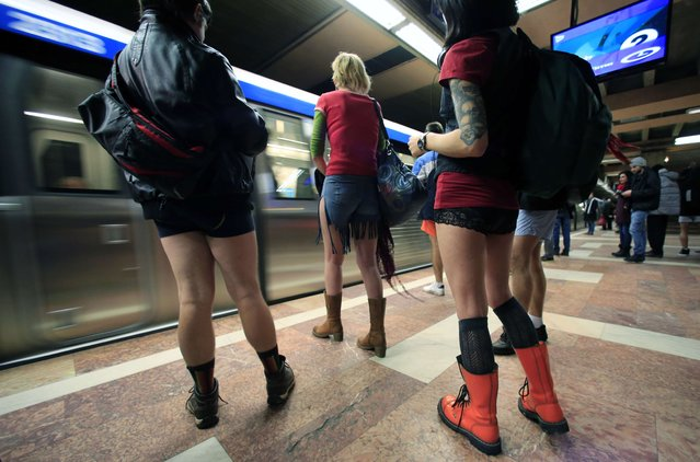 """Passengers without pants wait for the subway train during """"The No Pants Subway Ride"""" in Bucharest January 11, 2015. The event, the first organized in Romania, is an annual flash mob and occurs in different cities around the world, according to its organisers. (Photo by Radu Sigheti/Reuters)"""