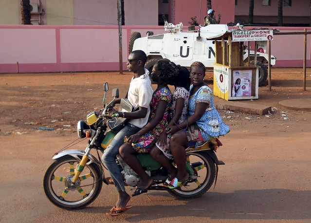 People ride a motorcycle near Koudoukou Mosque where Pope Francis meets Imam Tidiani Moussa Naibi in Bangui, Central African Republic, November 30, 2015. (Photo by Stefano Rellandini/Reuters)