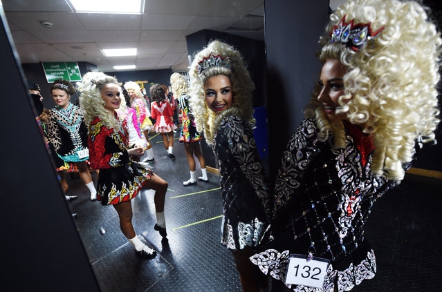 Competitors gather backstage as they prepare to take part in the All Ireland Irish Dancing Championships on November 2, 2016 in Belfast, Northern Ireland. The championships take place at the Waterfront Hall over the course of six days with winners qualifying for the World Irish Dancing Finals which will take place in Dublin next year. (Photo by Charles McQuillan/Getty Images)
